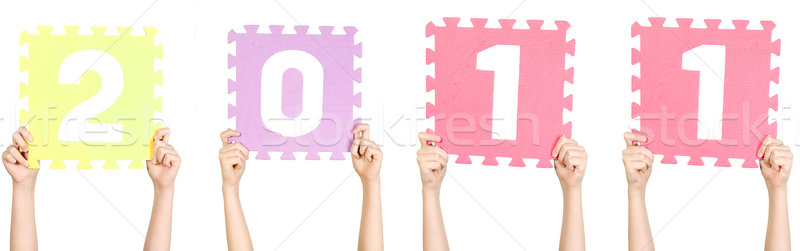 Child is holding 2011, new year concept Stock photo © carenas1