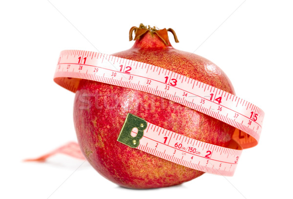 Tasteful fruit garnet with measuring tape Stock photo © carenas1