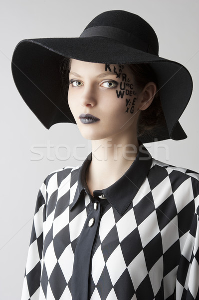 the letter on the face creative makeup girl, she looks in to the Stock photo © carlodapino
