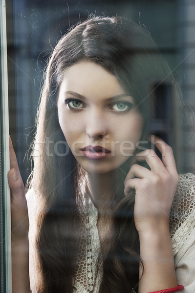 the thinking woman at window Stock photo © carlodapino