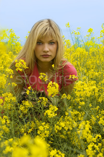 Lenyűgöző szemek gyönyörű szőke lány vonzó Stock fotó © carlodapino