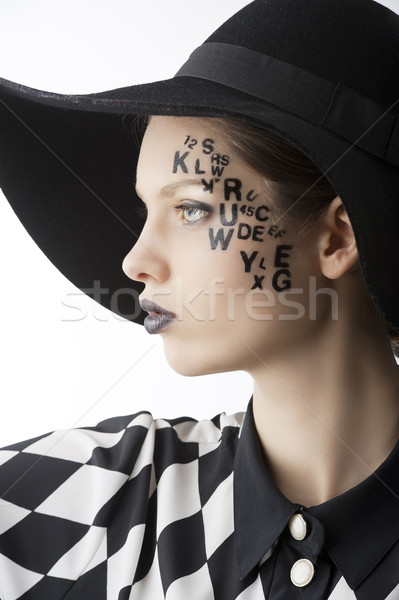 the letter on the face creative makeup girl, she is turned in pr Stock photo © carlodapino