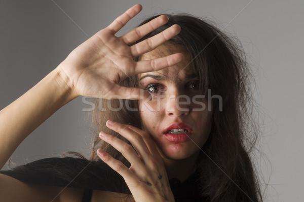 Erőszak fiatal nő tett kéz arc szépség Stock fotó © carlodapino