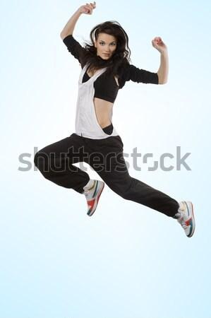 Lenyűgöző lány táncos ugrik barna hajú modern stílusú Stock fotó © carlodapino