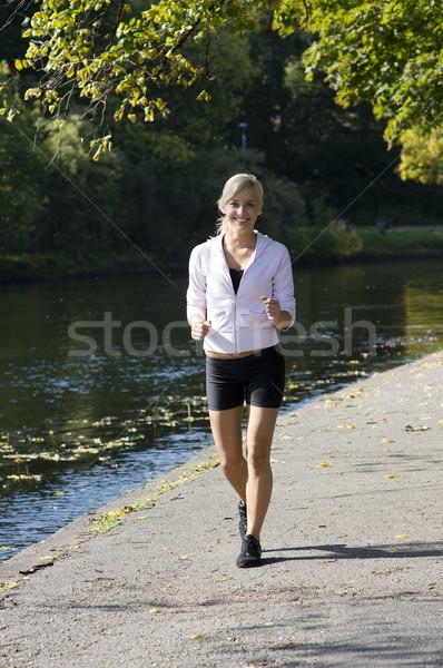 Lány fut csinos fiatal szőke park Stock fotó © carlodapino
