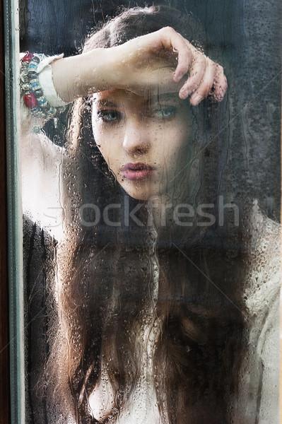 Düşünme kadın pencere aşağı portre Stok fotoğraf © carlodapino