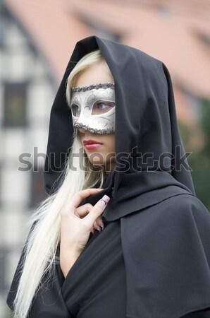 Sexy maschera ragazza seduta fiume Foto d'archivio © carlodapino