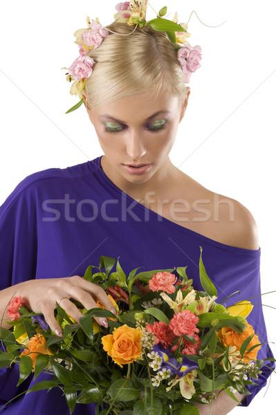 Regarder fleurs portrait joli jeunes Photo stock © carlodapino