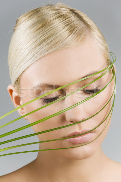 girl with grass over face Stock photo © carlodapino