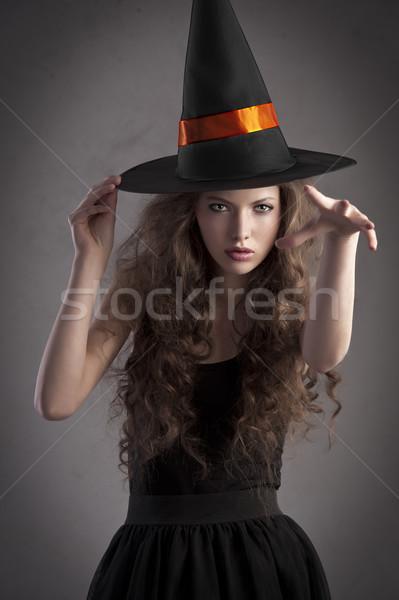 Dość dziewczyna ogromny kapelusz czarownicy cute Zdjęcia stock © carlodapino