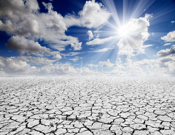 Agrietado suelo colorido dramático paisaje cielo azul Foto stock © carloscastilla