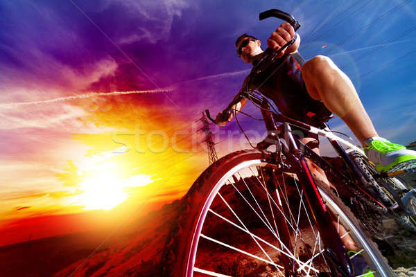 Sport and healthy life.Mountain bike and landscape background Stock photo © carloscastilla