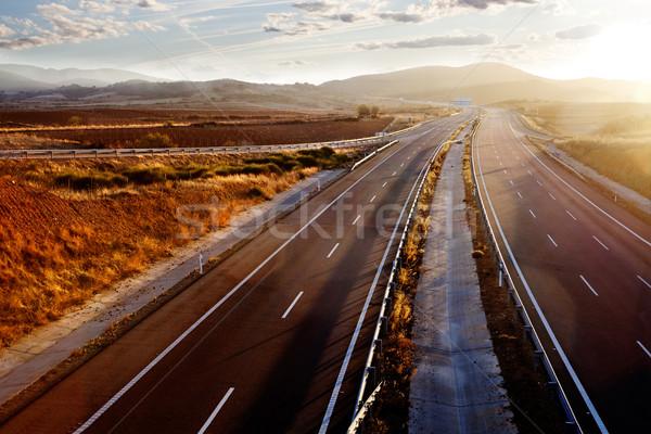 Sunset and road landscape Stock photo © carloscastilla