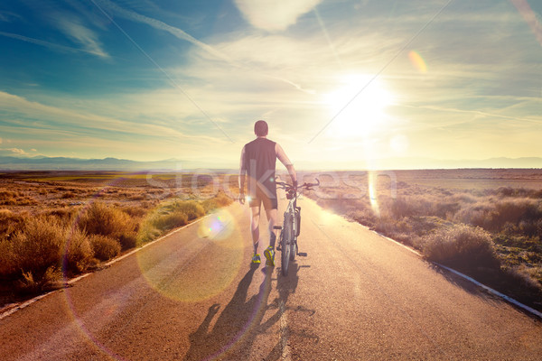 Bicycle sport and sunset.Road through the landscape. Stock photo © carloscastilla