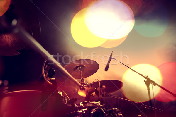 Musical background.Drumkit on stage lights performance Stock photo © carloscastilla