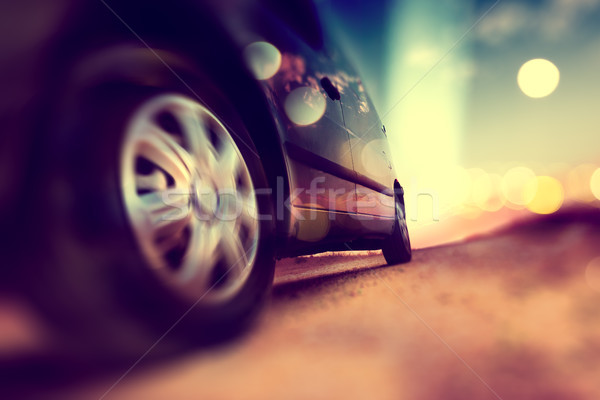 Trip and road .Drive in scenery sunset.Car wheels and tire  deta Stock photo © carloscastilla