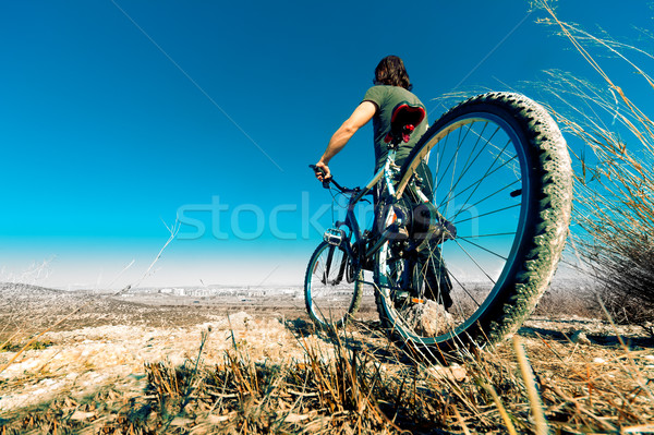 Mountain bike and young man Stock photo © carloscastilla