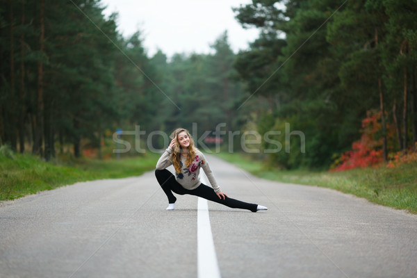 Young girl makes splits Stock photo © castenoid