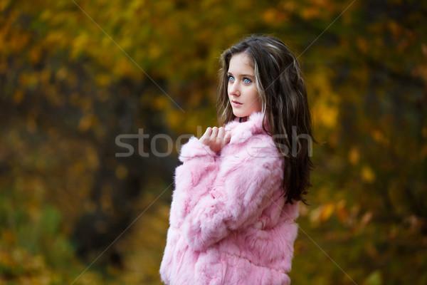 красивая девушка розовый шуба портрет желтый листьев Сток-фото © castenoid