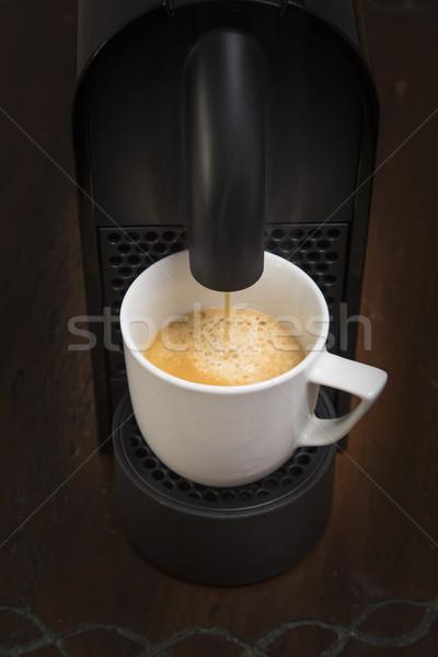 Stock photo: Coffee maker pouring espresso