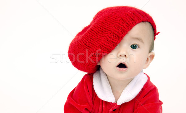 Infant Boy Sits lOOKING under his red hat Stock photo © cboswell