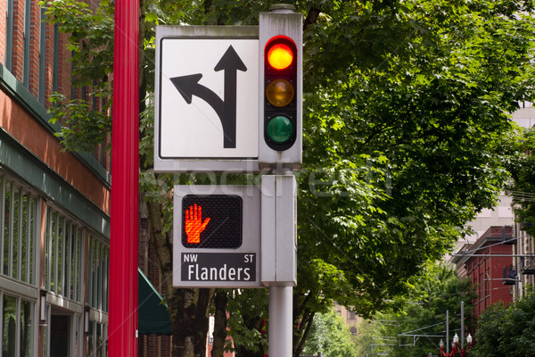 Traffic Pedestrian and Directional Symbols Signals Downtown Stre Stock photo © cboswell