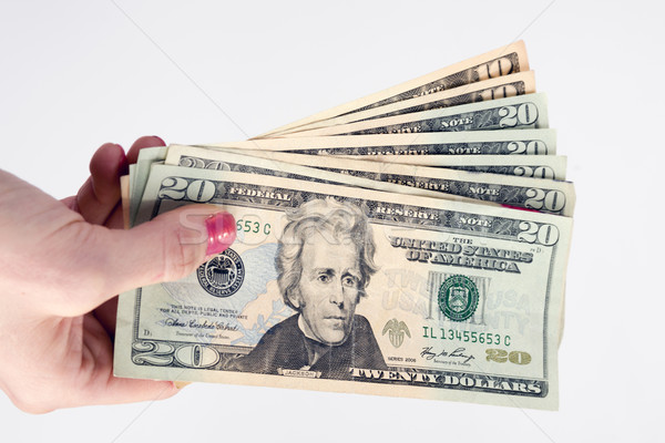 Female Hand Holds Cash Payment Currency Twenty Dollar Money Gree Stock photo © cboswell