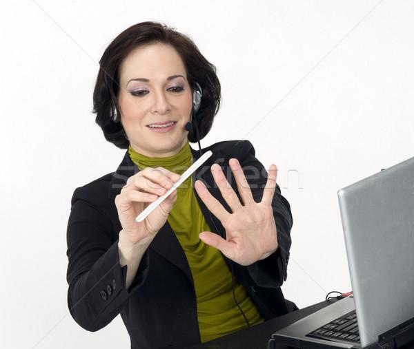 Müşteri hizmetleri kadın çivi saat kadın dizüstü bilgisayar Stok fotoğraf © cboswell