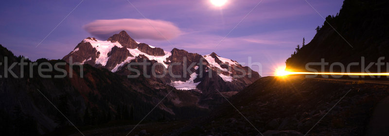Lone Car Passes on Roadway Full Moon Mt Shuksan Stock photo © cboswell