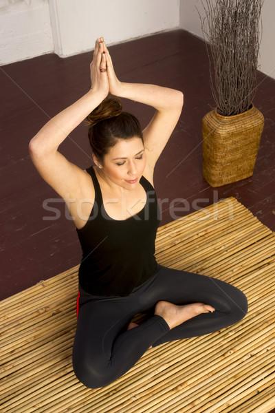 Nő nyújtott ülő jóga gyakorlat meditáció Stock fotó © cboswell