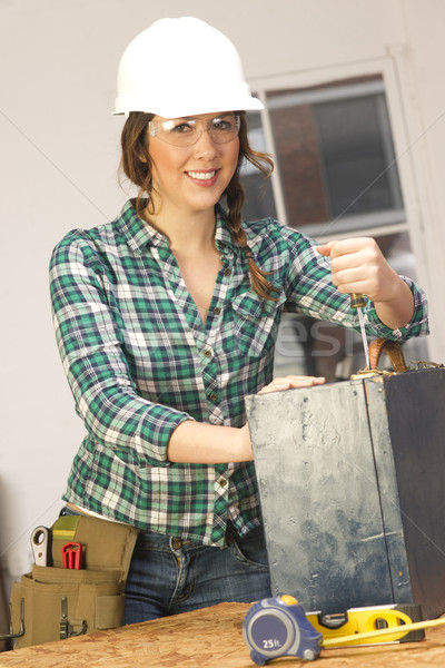 Woman Works on a Bench Repairing a Wooden Box Stock photo © cboswell