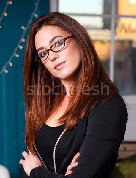 Intellectual Business Woman Wearing Glasses Head Tilted Stock photo © cboswell
