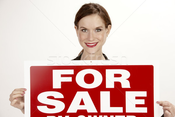 Attractive Female Realtor Holds up the For Sale Sign Stock photo © cboswell