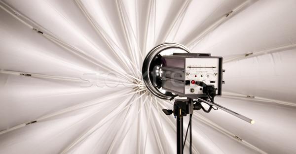 High Wattage Flash Head Lights up Large Studio Umbrella Stock photo © cboswell