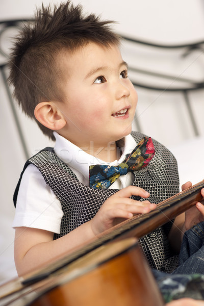 Happy Two Year Old Boy Interested in Arts and Music Stock photo © cboswell