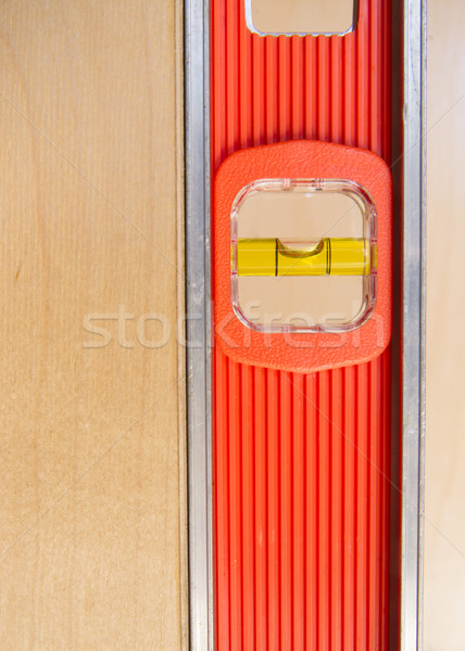 Old Door Gets Installed Leveled up By Long Orange Level Tool Stock photo © cboswell
