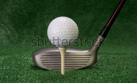 Club Sitting in Front of Teed Up Golf Ball Stock photo © cboswell