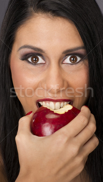 Big Brown Eyed Woman Eats Food Fruit Red Delicious Apple Stock photo © cboswell