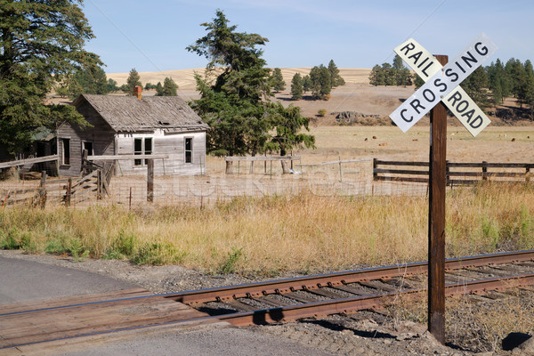 Railroad Crossing Sign Tracks Abandoned House Rural Ranch Farmla Stock photo © cboswell