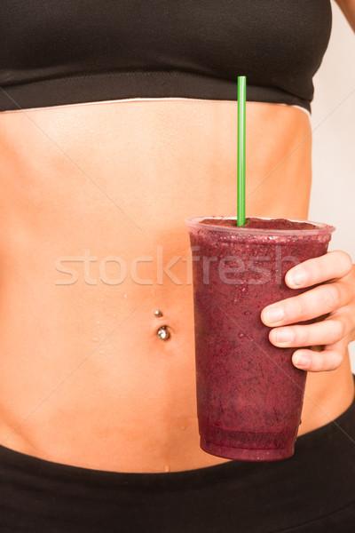 Slender Female Torso Tanned Toned Body Blended Fruit Smoothie Drink Stock photo © cboswell