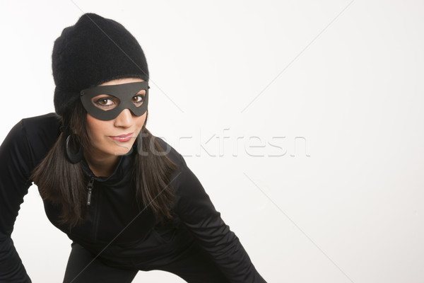 Masked Woman Sneaking Lurking Around Looking For Something to St Stock photo © cboswell
