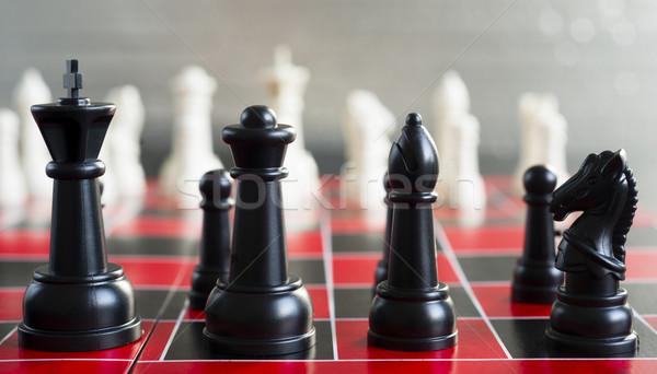 Red Black Chess Board Game Pieces King Queen Bishop Knight Stock photo © cboswell
