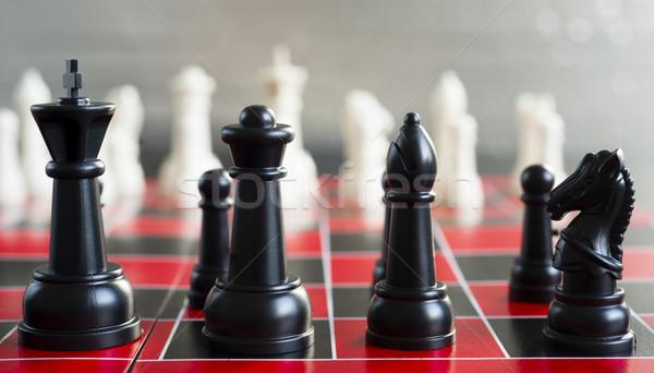 Kırmızı siyah satranç tahtası oyun parçalar kral Stok fotoğraf © cboswell