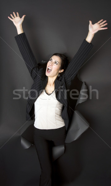 Business Woman Breaks Through Black Barrier  Stock photo © cboswell