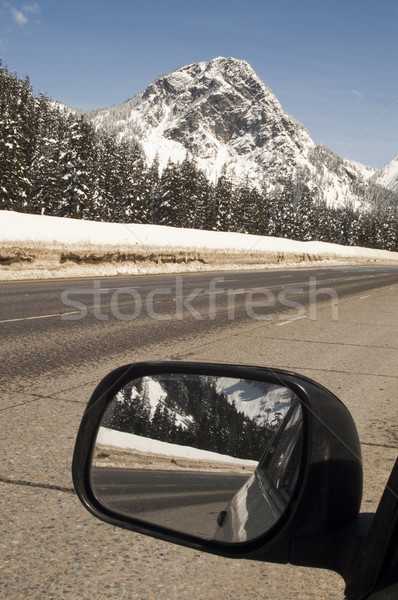 Driver Checks Rear View Mirror Motoring North Cascades Washingto Stock photo © cboswell