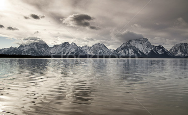 Lake Reflection Cloud Cover Jagged Peaks Grand Teton Wyoming  Stock photo © cboswell