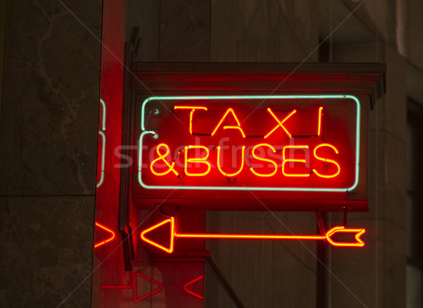 Red Neon Sign Indoor Signage Arrow Pointing Taxi Buses Stock photo © cboswell