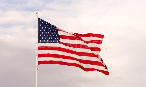 Szél integet fényes hazafias amerikai zászló csillagok Stock fotó © cboswell