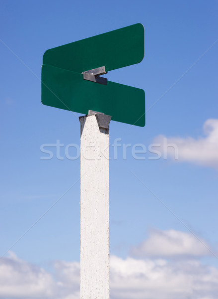 Blank Signs Crossraods Street Avenue Sign Blue Skies Clouds Stock photo © cboswell