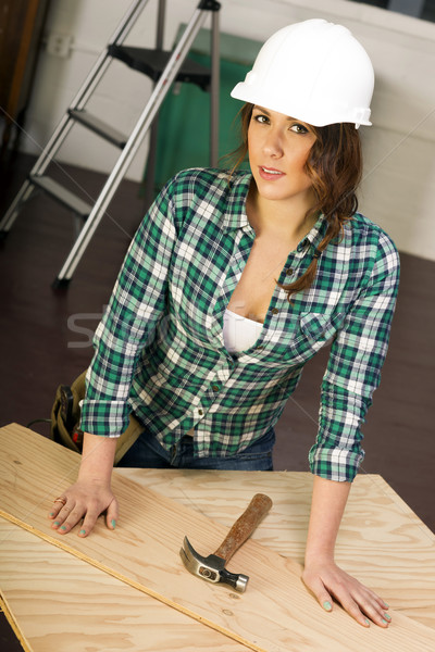Woman Works on Construction Project Plywood Hardhat Tools Hammer Stock photo © cboswell